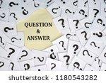 question mark on white paper... | Shutterstock . vector #1180543282