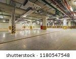 modern underground parking... | Shutterstock . vector #1180547548