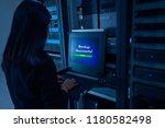 female network administrator in ... | Shutterstock . vector #1180582498
