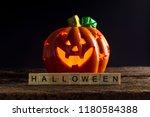 wooden text of halloween and... | Shutterstock . vector #1180584388