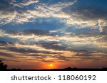 A spectacular sunset with amazing cloud formations in the Kgalagadi Transfrontier Park - stock photo
