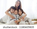 family portrait of mother and... | Shutterstock . vector #1180605835