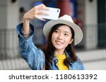 young cute asian woman in... | Shutterstock . vector #1180613392