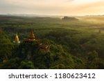beautiful sunrise with pagoda... | Shutterstock . vector #1180623412