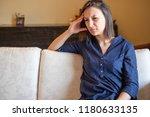 young woman feeling migraine... | Shutterstock . vector #1180633135