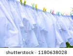 white shirts hanging outside on ... | Shutterstock . vector #1180638028