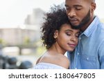 tender black couple hugging... | Shutterstock . vector #1180647805