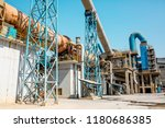 cement factory. pipes and... | Shutterstock . vector #1180686385