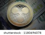 ripple xrp on banknotes.... | Shutterstock . vector #1180696078