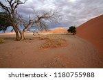 sand dunes in the salt pan of... | Shutterstock . vector #1180755988