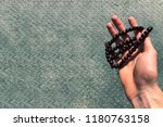 rosary of mahogany in the hand... | Shutterstock . vector #1180763158
