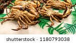 crabs at the fish market... | Shutterstock . vector #1180793038