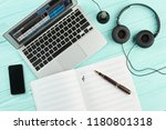 desk with laptop  headphones... | Shutterstock . vector #1180801318