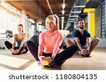 young tired athletes in a gym... | Shutterstock . vector #1180804135