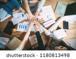 team of colleagues with their... | Shutterstock . vector #1180813498