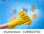 hand in yellow rubber glove... | Shutterstock . vector #1180823782