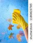 hand in yellow rubber glove... | Shutterstock . vector #1180823785