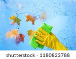 hand in yellow rubber glove... | Shutterstock . vector #1180823788