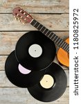 vinyl records and wooden guitar.... | Shutterstock . vector #1180825972