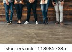 group of people leaning against ... | Shutterstock . vector #1180857385