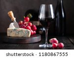 glass of red wine with blue... | Shutterstock . vector #1180867555