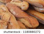 tasty baguettes in the market | Shutterstock . vector #1180880272
