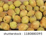 yellow quince in the market | Shutterstock . vector #1180880395