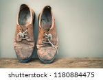 pair of old weathered leather... | Shutterstock . vector #1180884475