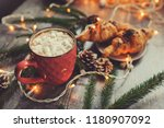 hot cocoa with marshmallows and ... | Shutterstock . vector #1180907092