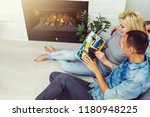 young happy couple sitting side ... | Shutterstock . vector #1180948225