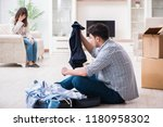 woman evicting man from house... | Shutterstock . vector #1180958302