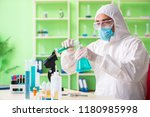 chemist working in the lab on... | Shutterstock . vector #1180985998