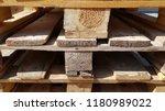 old wooden pallet in sunlight.... | Shutterstock . vector #1180989022