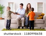 young parents giving out... | Shutterstock . vector #1180998658