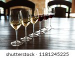 glasses of white and red wines... | Shutterstock . vector #1181245225