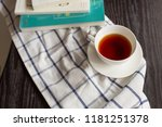 tea of white cup on wooden desk ... | Shutterstock . vector #1181251378