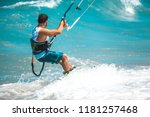 kitesurfing. the young man is... | Shutterstock . vector #1181257468