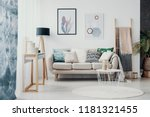 posters above sofa with pillows ... | Shutterstock . vector #1181321455