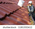 the man on ladder cleans the... | Shutterstock . vector #1181332612