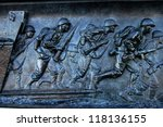 A panel from the National World War II Memorial in Washington, D.C. depicting an amphibious landing in the Pacific theater