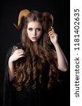 portrait of an attractive demon ... | Shutterstock . vector #1181402635