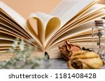 heart shaped of old book page... | Shutterstock . vector #1181408428
