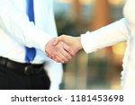 closeup .the handshake of a...   Shutterstock . vector #1181453698