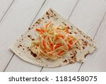 cabbage salad and pita bread on ...   Shutterstock . vector #1181458075