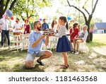 father giving a cake to a small ... | Shutterstock . vector #1181463568