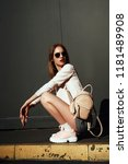 trendy young woman with bag...   Shutterstock . vector #1181489908