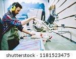professional male carpenter in... | Shutterstock . vector #1181523475