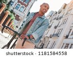 pastime. young guy walking on...   Shutterstock . vector #1181584558