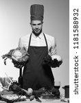 chef in burgundy uniform holds...   Shutterstock . vector #1181588932