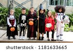 diverse kids in halloween... | Shutterstock . vector #1181633665